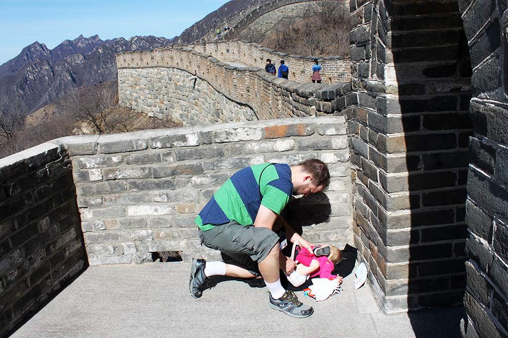 diaper change on the great wall of china diapers on a plane