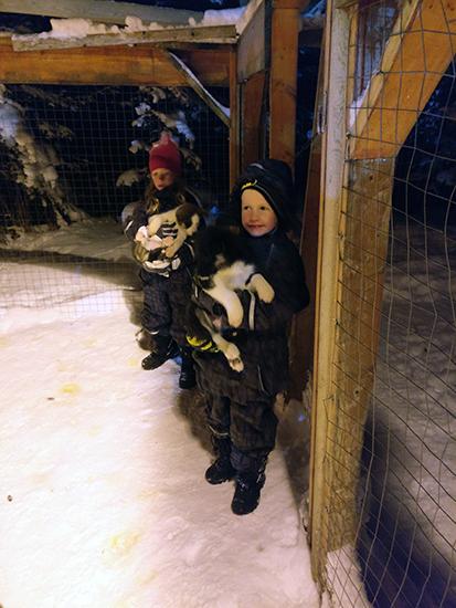 kids playing with Husky